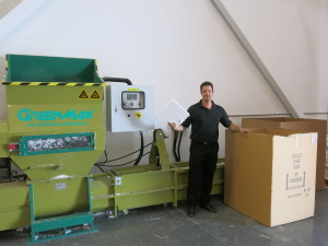 McArthur General Manager, Darin Pound beside the densifier.