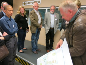 APRA's president, Dave Schwass and executive director, Grant Cameron gaze at the plans of the recycling centre.